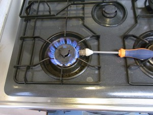 ガスコンロで焼きます